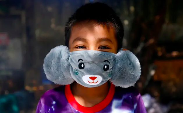 child wearing a face mask made from grey teddy bear